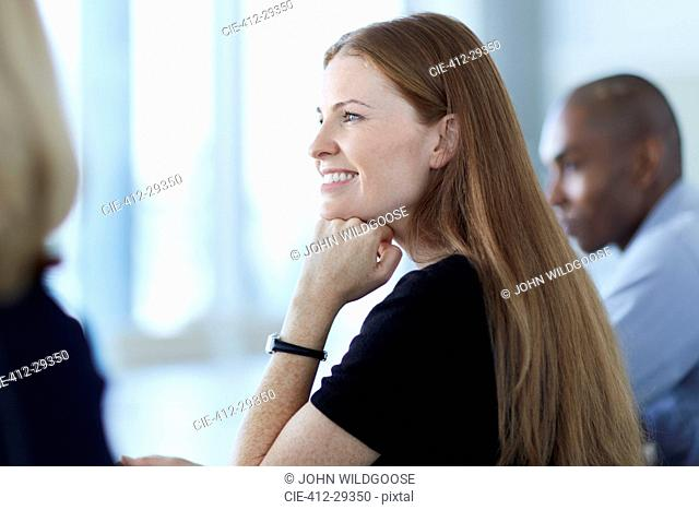 Confident businesswoman listening in meeting