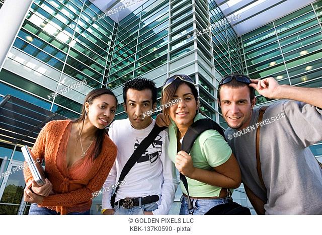 College students standing in front of a building