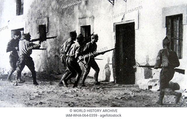 Nationalist Troops search homes in the town of Irun during the Spanish Civil War 1936