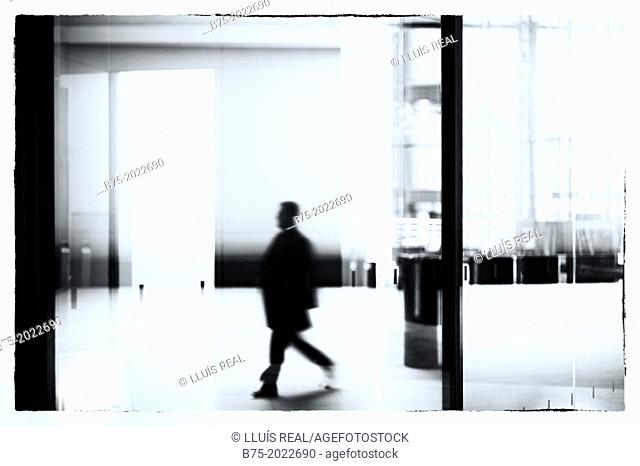 Hall of an office building with a unrecognizable executive, City, London, England, UK
