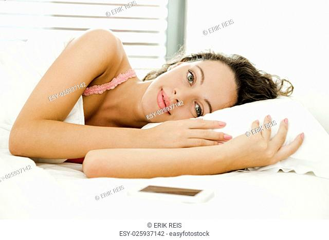Beautiful woman in the bed with lazy to get up