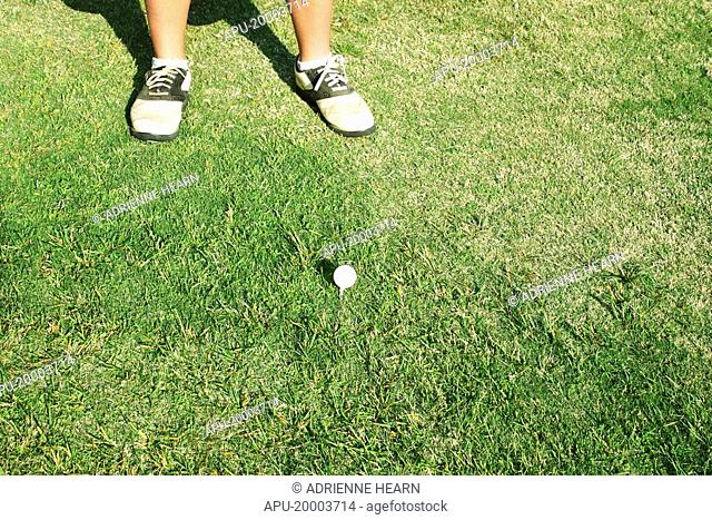 Golfer lines by his tee box