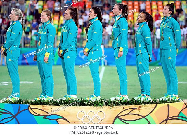 Team of Australia celebrates after winning the women's Rugby Sevens gold medal match between Australia and New Zealand at the Rio 2016 Olympic Games at the...