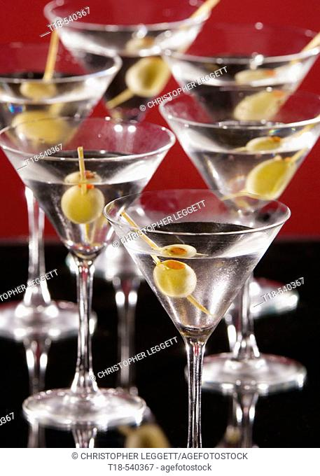 glasses of martini with olive