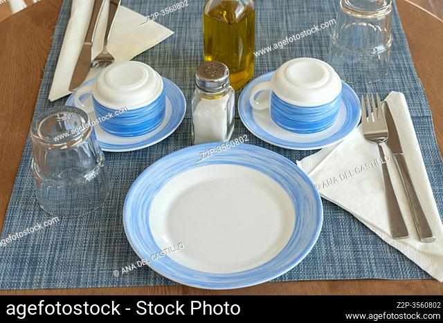 Breakfast tableware for a couple on round table in summer flat Spain