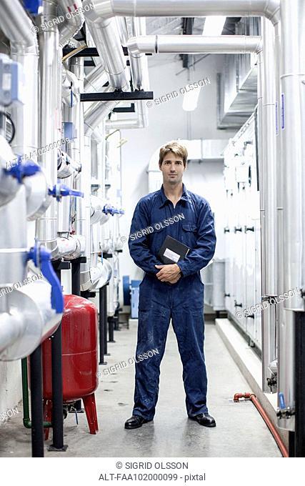Worker in industrial plant, portrait