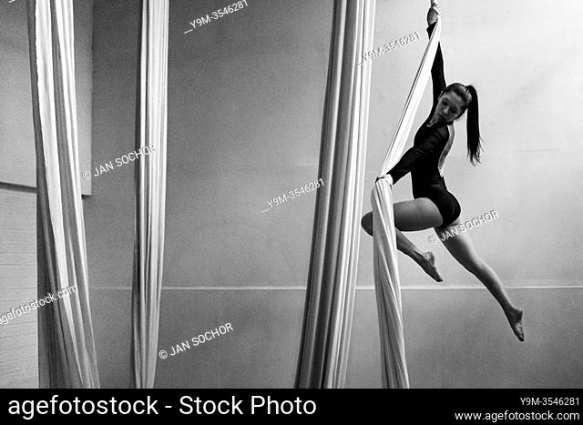 A Colombian aerial dancer performs a choreography on aerial silks during a training session in a gym in Medellín, Colombia, 19 October 2019