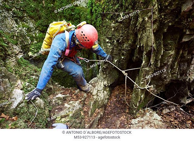 adult female caver start descending in the cave known as 'pozzo della neve'  matese mountain range  municipality of campochiaro  province of campobasso  molise...
