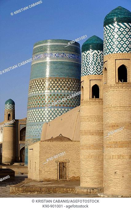 The unfinished Kalta Minor Minaret with the entrance of the Kuhna Ark in the foreground, Khiva, Uzbekistan, Central Asia