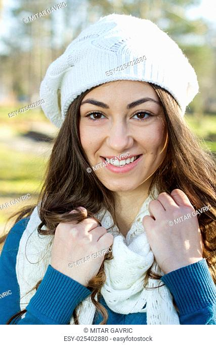 Portrait of Happy Beautiful Young Woman in the park. Winter or autumn season outdoor