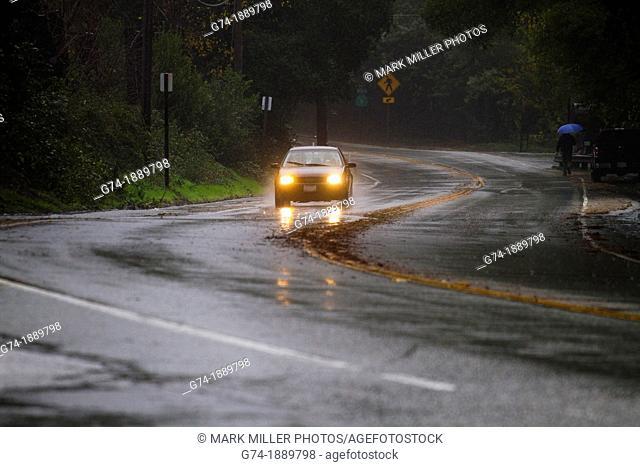Car Driving with Headlights on in Rain Storm in hills of California near Santa Cruz