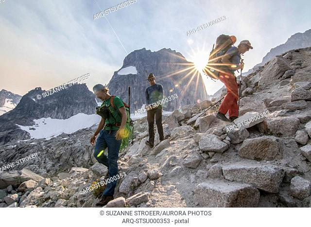 Group of three mountain climbers in Bugaboo Mountains, British Columbia, Canada