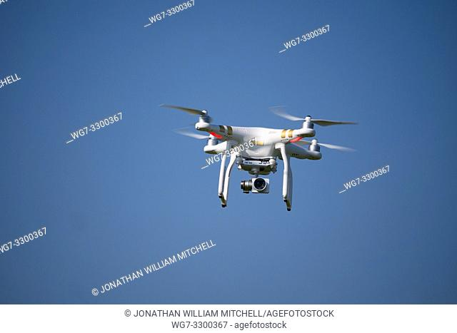NORTHAMPTONSHIRE, UK - 21 April, 2019 - File image dated 20 Apr 2019 of a DJI Phantom 3 Pro drone in the air. A UK Airprox report has detailed a near-miss...