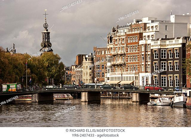 The Amstel River with Munttoren clock tower in Muntplein square in Amsterdam