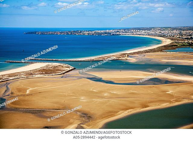 In the foreground Alvor estuary, Natural Reseve. In the background Meia praia beach, Lagos and Ponta da Piedade, Faro district. Algarve, Portugal