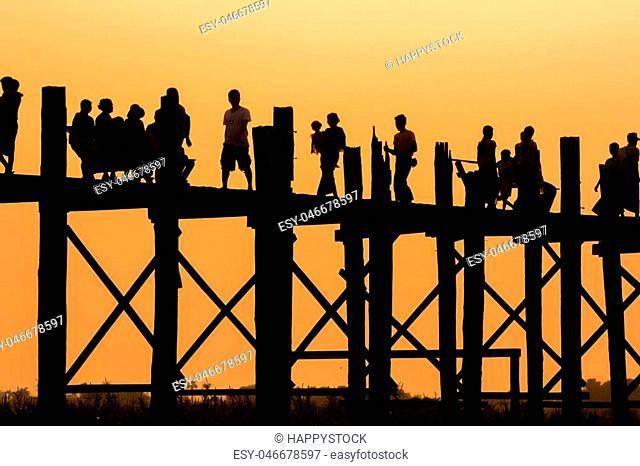 Silhouette fo people walking at U Bein Bridge, Mandalay, Myanmar