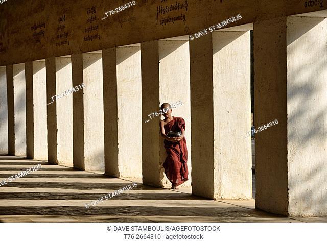 A young monk in the entrance corridor to Shwezigon Paya, Bagan, Myanmar
