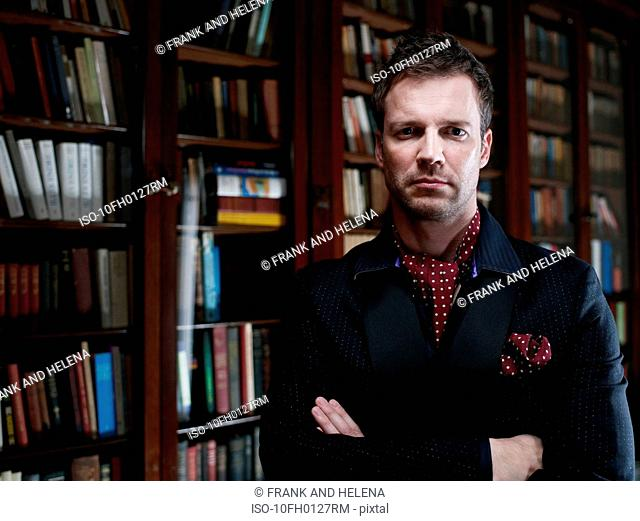 Man in suit standing in library