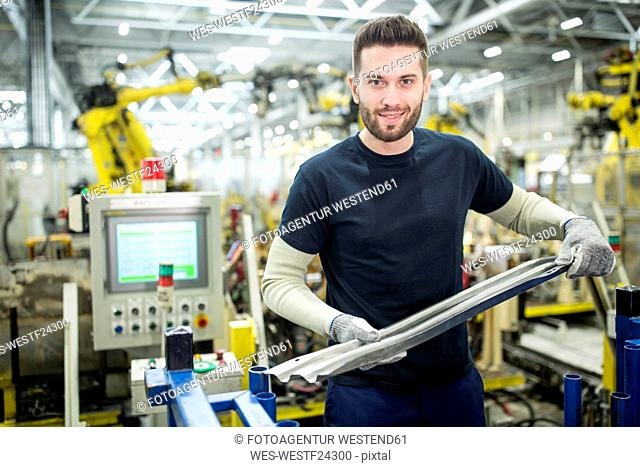Portrait of confident man working in a modern factory