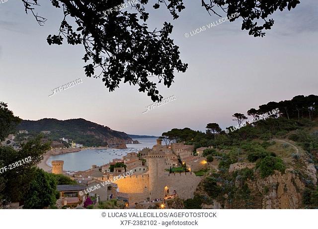 Tossa de Mar. Walls of old city (Villa Vella). In background Gran beach.Costa Brava. Girona province. Catalonia. Spain