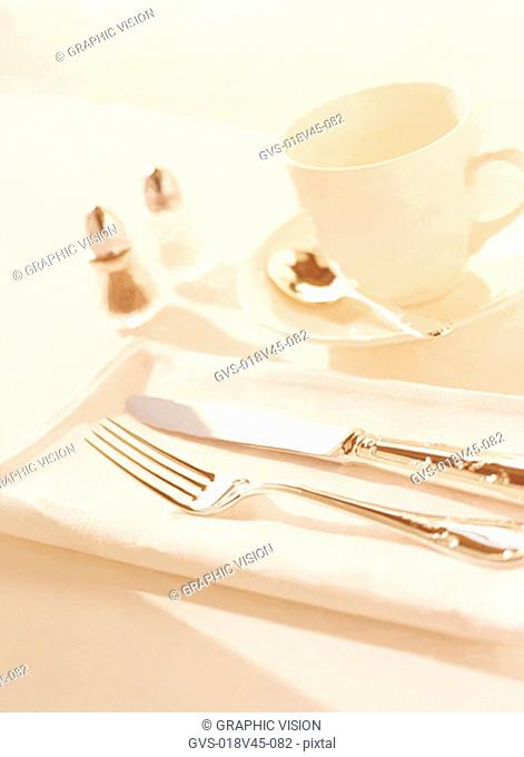 Close Up of Knife Fork and Tea Cup and Saucer