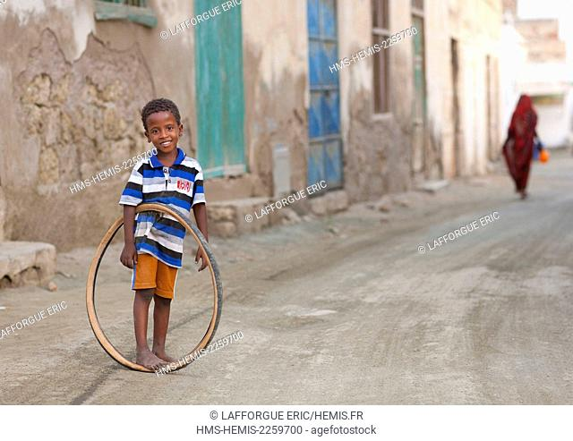 Eritrea, Horn Of Africa, Massawa, kid playing with a bicycle tyre