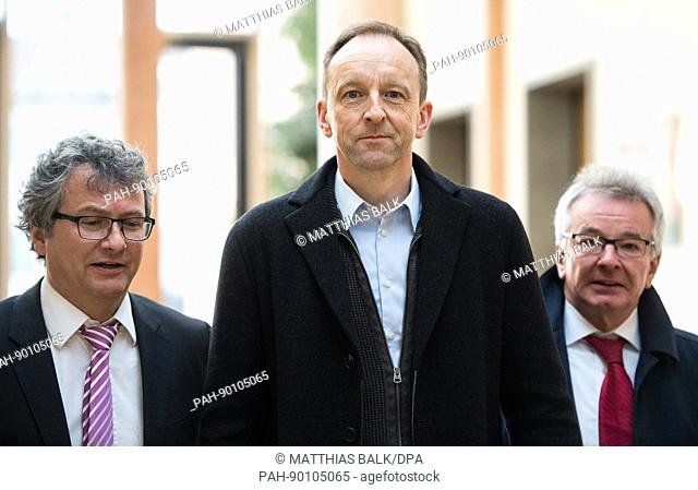 Dietmar Schach (R), former managing director of the closed-down Sieber sausage factory arrives for his trial with his lawyers Martin Hintermayer and Andreas...