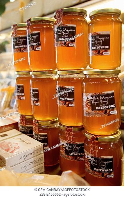 Close-Up shot of Cretan honey jars in market hall, Chania, Crete, Greek Islands, Greece, Europe
