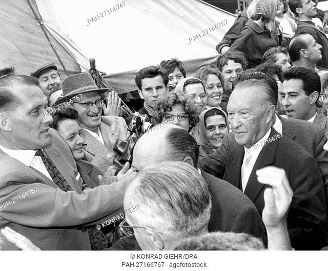 German chancellor Konrad Adenauer (fr) drives to refugee camp Marienfelde on the 22nd of August in 1961, where he waves at the refugees