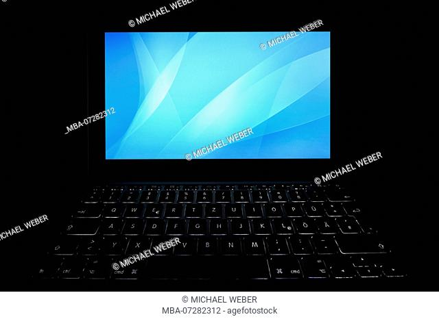 Laptop with blank display, blue screen, cybercrime Symbolical image, data protection