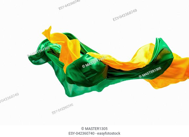 Smooth elegant transparent yellow, green cloth isolated or separated on white studio background. Texture of flying fabric