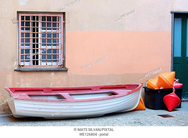 Boat on the land under a window in cinque terre ligura italy