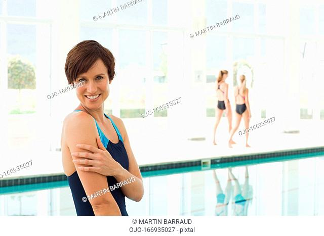 Portrait of smiling woman at swimming pool