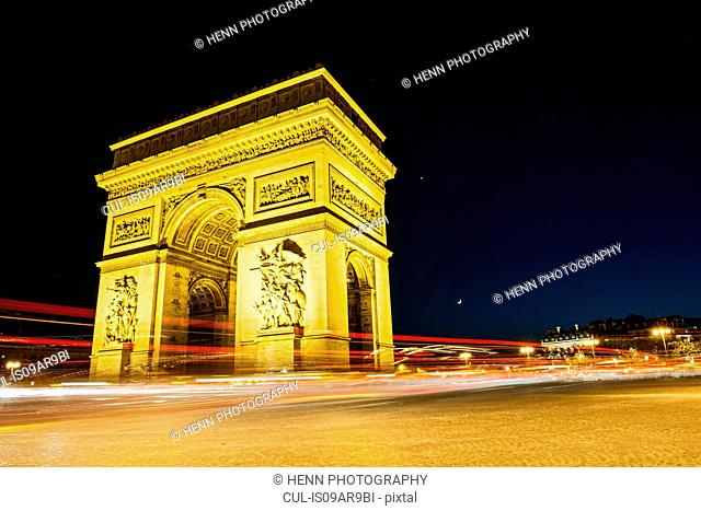 View of the Arc de Triomphe and traffic at night, Paris, France