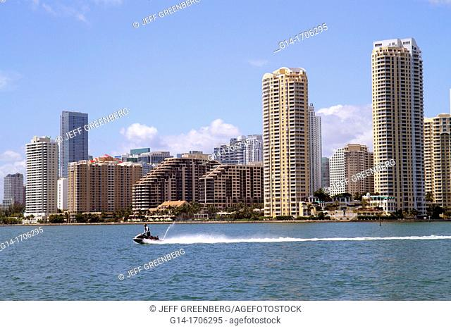 Florida, Miami, Biscayne Bay, city skyline, high-rise, condominium, buildings, water, Brickell Key, jet ski