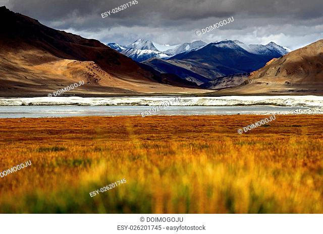 Lake on himalayas with high snow mountain