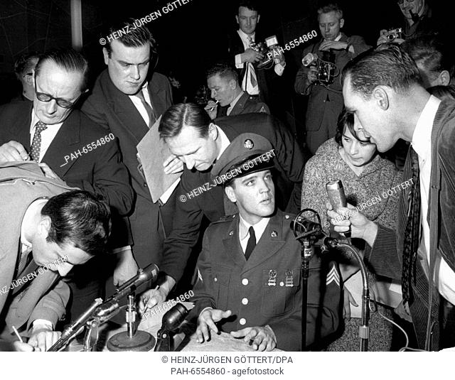 American teenager idol Elvis Presley (in uniform) is surrounded by media at the press conference in the Ray barracks in Friedberg in Hesse on the 1st of March...
