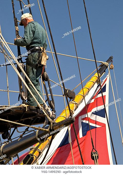 Old english sailor repairs the rigging in the mizzen mast  Vannes, Bay of Morbihan, Brittany, France, Europe