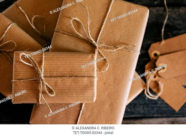 Presents wrapped in brown paper and string