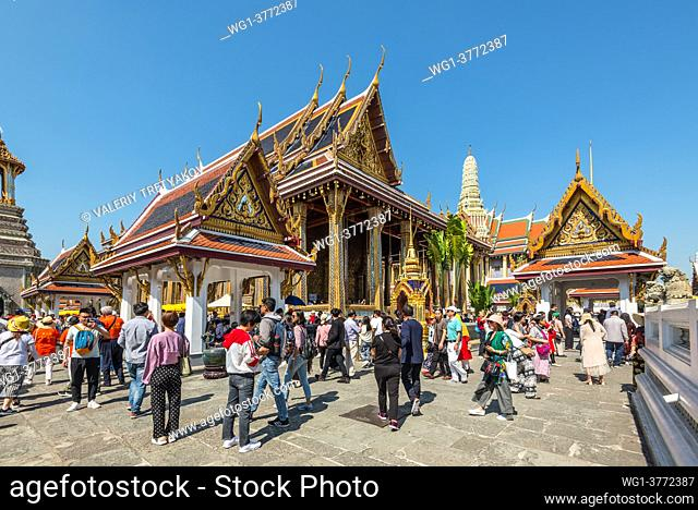 Bangkok, Thailand - December 7, 2019: Many tourists in the Wat Phra Kaew - the Temple of Emerald Buddha in Bangkok, Thailand