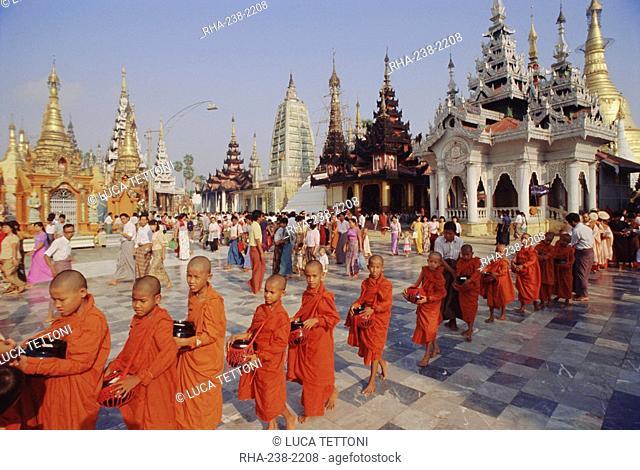 Line of Buddhist monks with begging bowls, Shwedagon Shwe Dagon Pagoda, Yangon Rangoon, Myanmar Burma, Asia