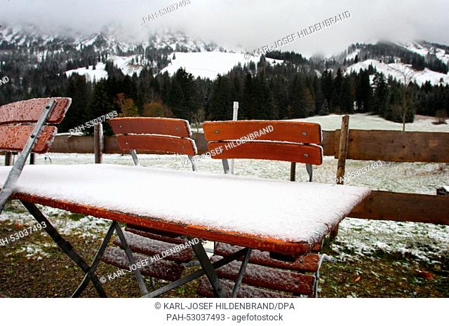 Tables and benches covered in snow in a biergarten in Oberjoch, Germany, 22 October 2014. Stormy winds brough cold air and snow to Bavaria - at least to higher...