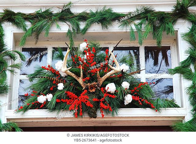 Christmas Decorations, made of natural product, adorn a doorway in Williamsburg Virginia