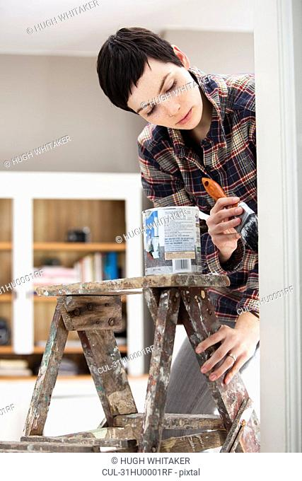 Young woman decorating house
