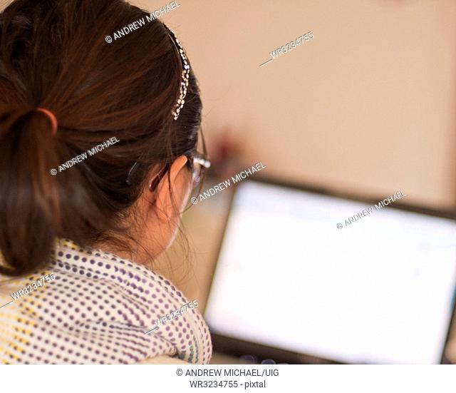 A South Korean young woman using a laptop