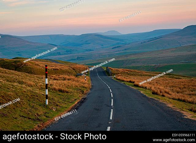 Driving on the Buttertubs Pass (Cliff Gate Rd) between Thwaite and Simonstone, North Yorkshire, England, UK