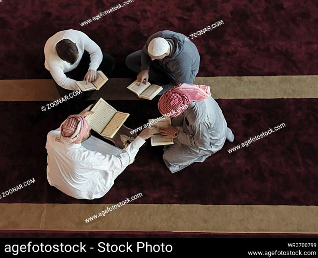 top view of muslim people in mosque reading quran together concept of islamic education and school of holly book kuran