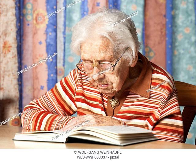 Portrait of senior woman reading a book