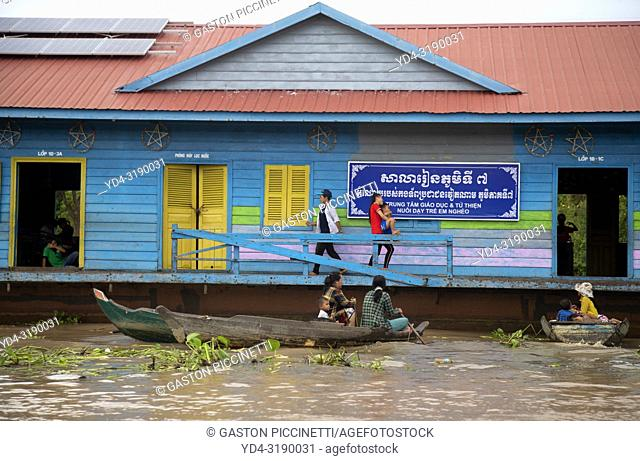 People from the village in their boat, Chang Kneas floating village, Siem Reap Province, Cambodia. Chang Kneas, is one of the more than 170 villages surrounding...