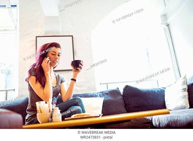 woman who take a phone call and a coffee